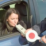 photo depicting clinical tests sobriety state driver by a policeman